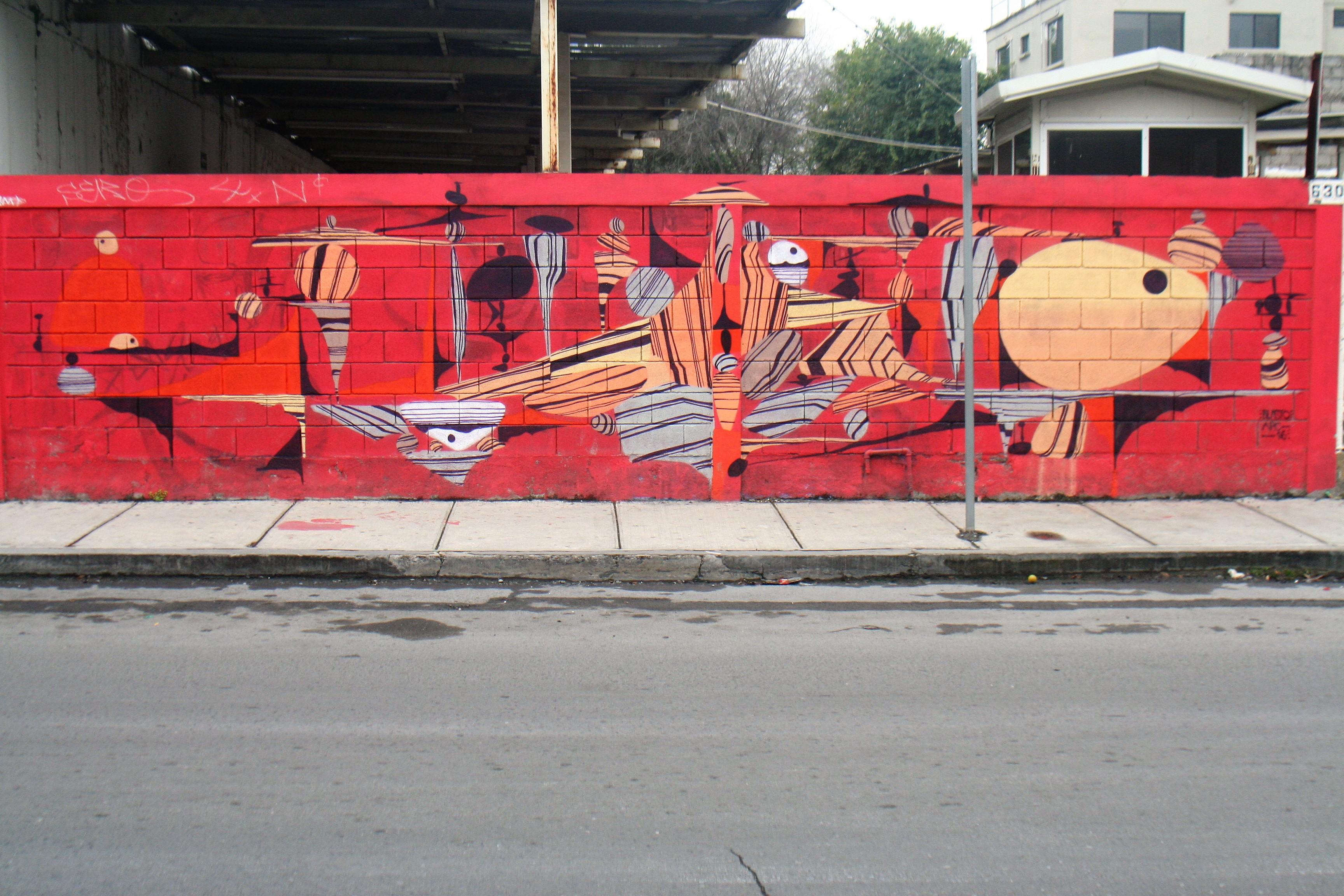 En tonos rojos, este mural nos incita a perdernos en él y entre sus formas que nos llevan a otra dimensión. / FOTO: Ada Rodríguez